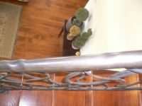 iron-anvil-railing-by-others-carmel-jensen-hand-rail-round-distressed-pipe