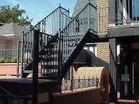iron-anvil-railing-by-others-rail-spiral-stair-virgina-street-2-1-3