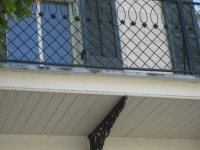 iron-anvil-railing-by-others-x-pattern-rail-with-doily-1-2