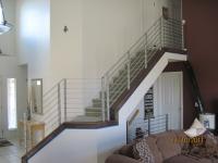 iron-anvil-railing-horizontal-round-bar-hansen-installation-8