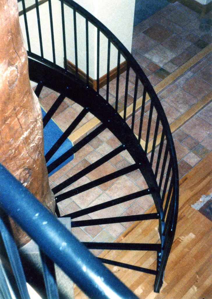 iron-anvil-stairs-spiral-angle-iron-no-tread-around-a-tree-42-1050-mike-holmes-17