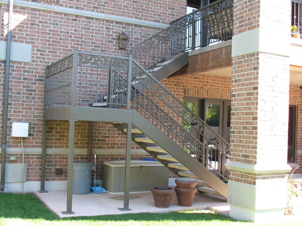 iron-anvil-stairs-double-stringer-treads-concrete-diamond-pattern-gustaferson-1