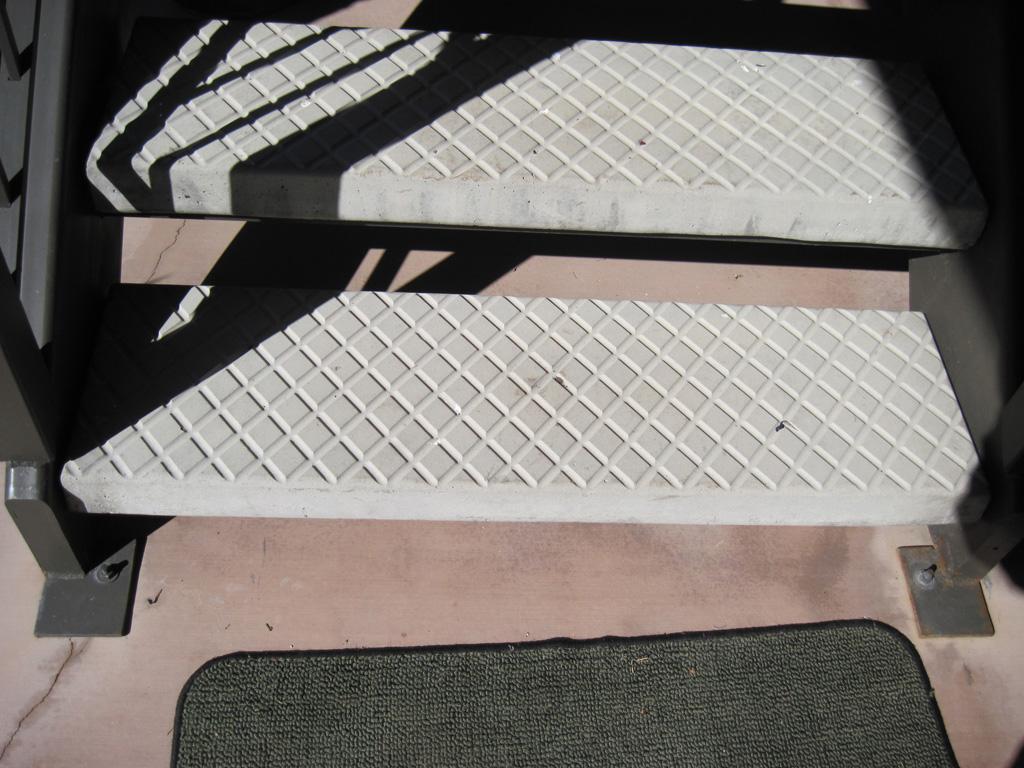 iron-anvil-stairs-double-stringer-treads-concrete-diamond-pattern-gustaferson-10