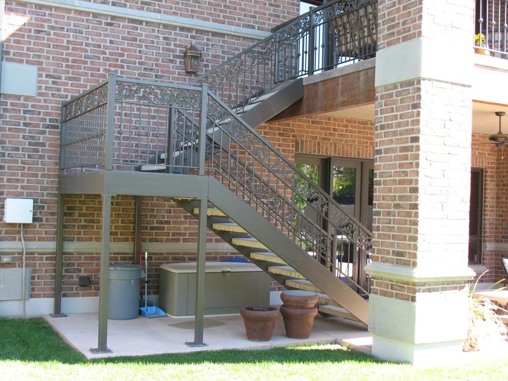 iron-anvil-stairs-double-stringer-treads-concrete-diamond-pattern-gustaferson-2