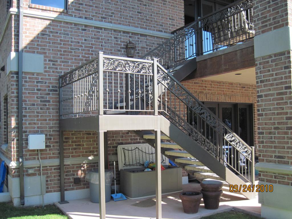 iron-anvil-stairs-double-stringer-treads-concrete-diamond-pattern-gustaferson-3