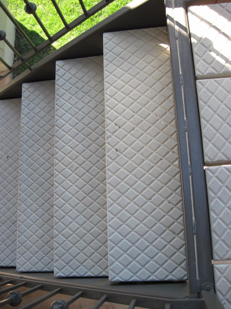 iron-anvil-stairs-double-stringer-treads-concrete-diamond-pattern-gustaferson-6
