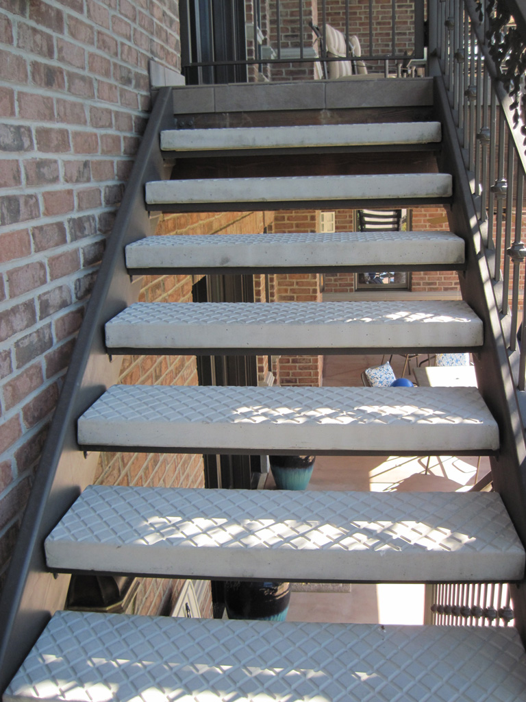 iron-anvil-stairs-double-stringer-treads-concrete-diamond-pattern-gustaferson-7