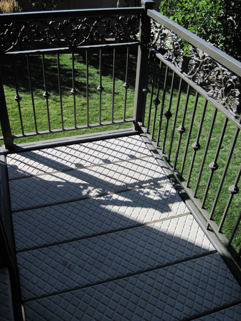 iron-anvil-stairs-double-stringer-treads-concrete-diamond-pattern-gustaferson-8