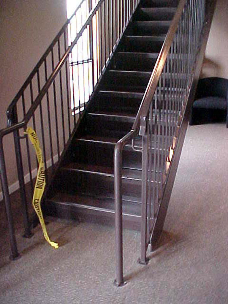 iron-anvil-stairs-double-stringer-treads-concrete-fill-njm-office-1
