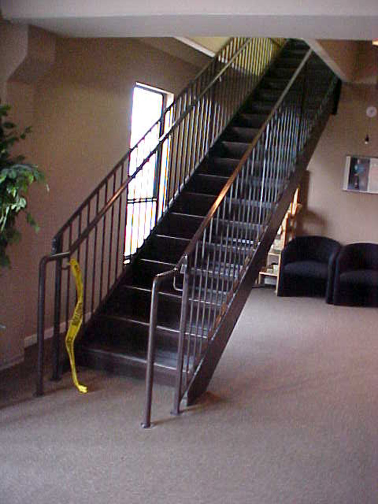 iron-anvil-stairs-double-stringer-treads-concrete-fill-njm-office-2