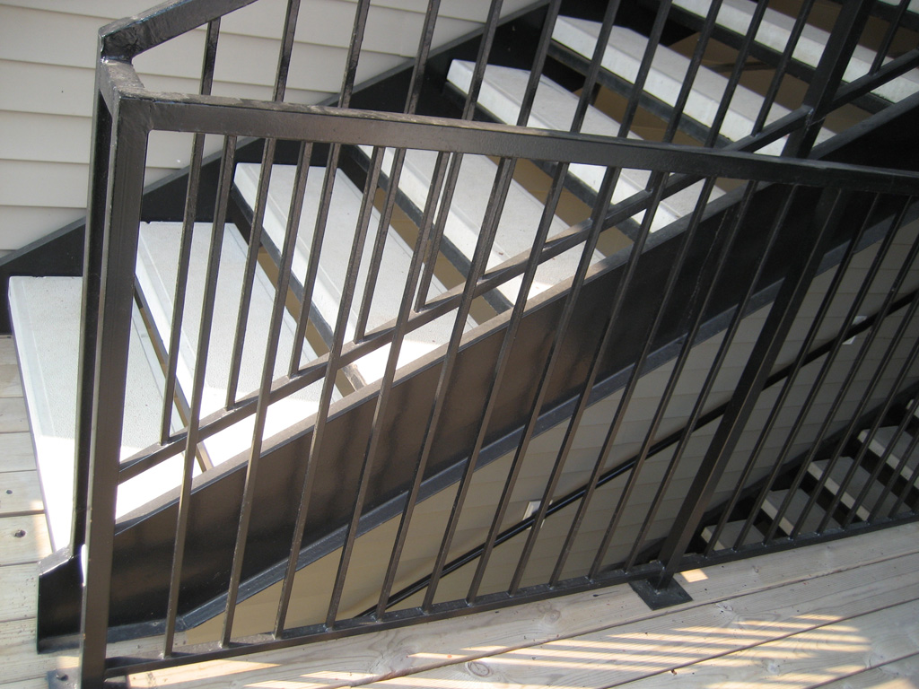 iron-anvil-stairs-double-stringer-treads-concrete-smooth-by-others1