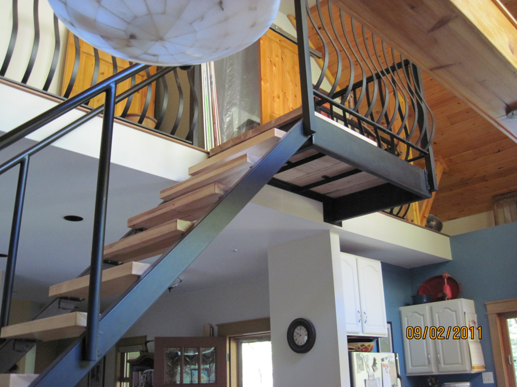 iron-anvil-stairs-double-stringer-treads-wood-byrne-immigration-1