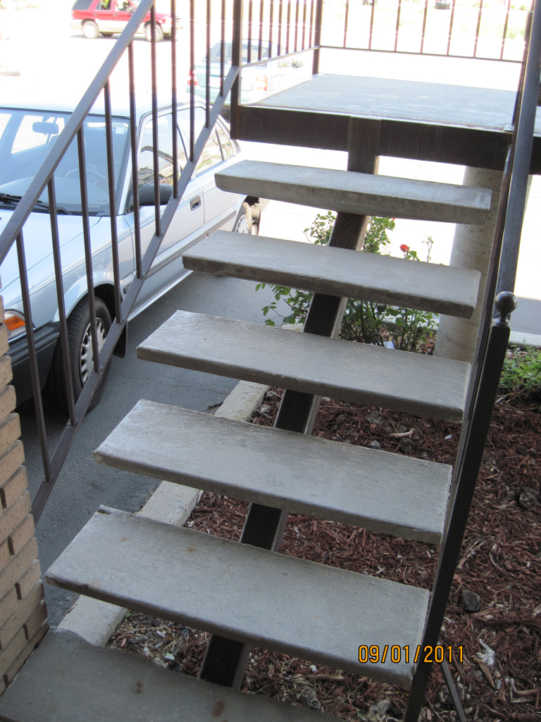 iron-anvil-stairs-single-stringer-treads-concrete-smooth-fairbanks-const-15712-stair-repair-by-others-1