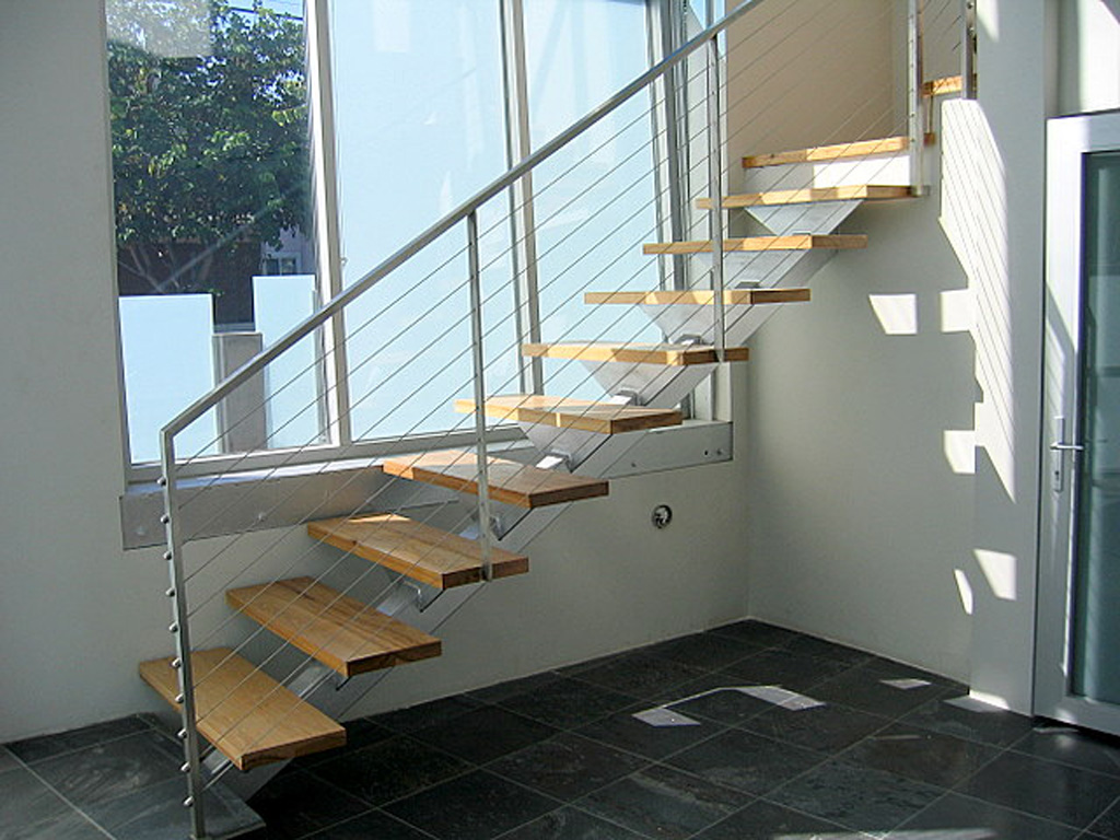 iron-anvil-stairs-single-stringer-treads-wood-by-others-2