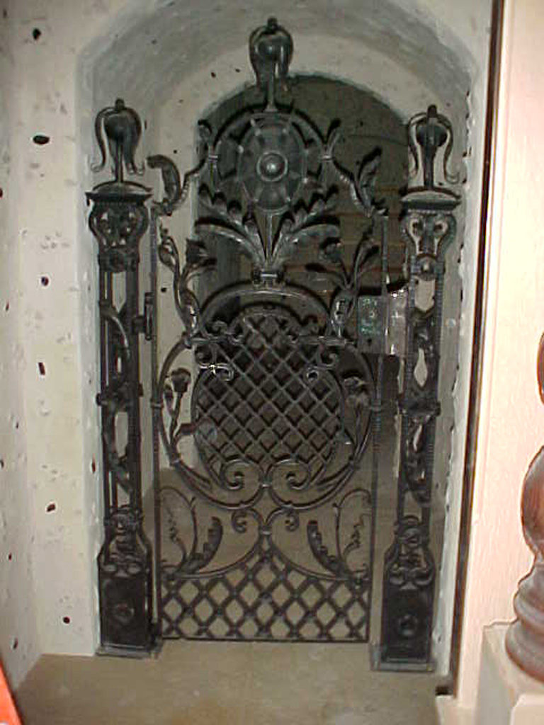 iron-anvil-gates-by-others-man-scroll-wine-cellar