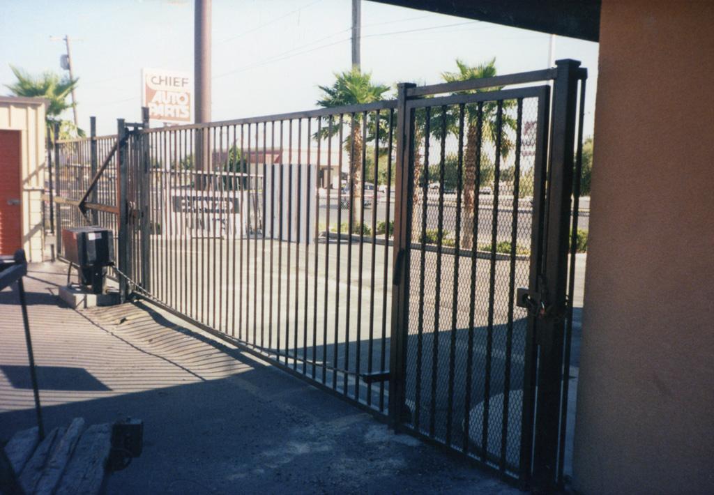 iron-anvil-gates-driveway-flat-storage-facility