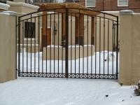 iron-anvil-gates-driveway-arch-gustafson-on-yale