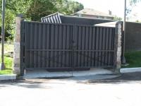 iron-anvil-gates-driveway-flat-gold-medallion-garbage-s