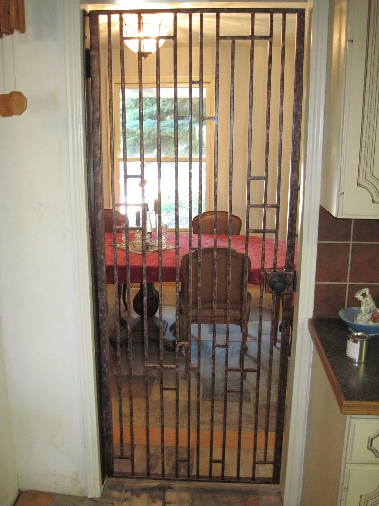 61-0731-Iron-Anvil-Gates-Man-Flat-RANNEY-15960-GATE-FRANK-LLOYD-WRIGHT-799