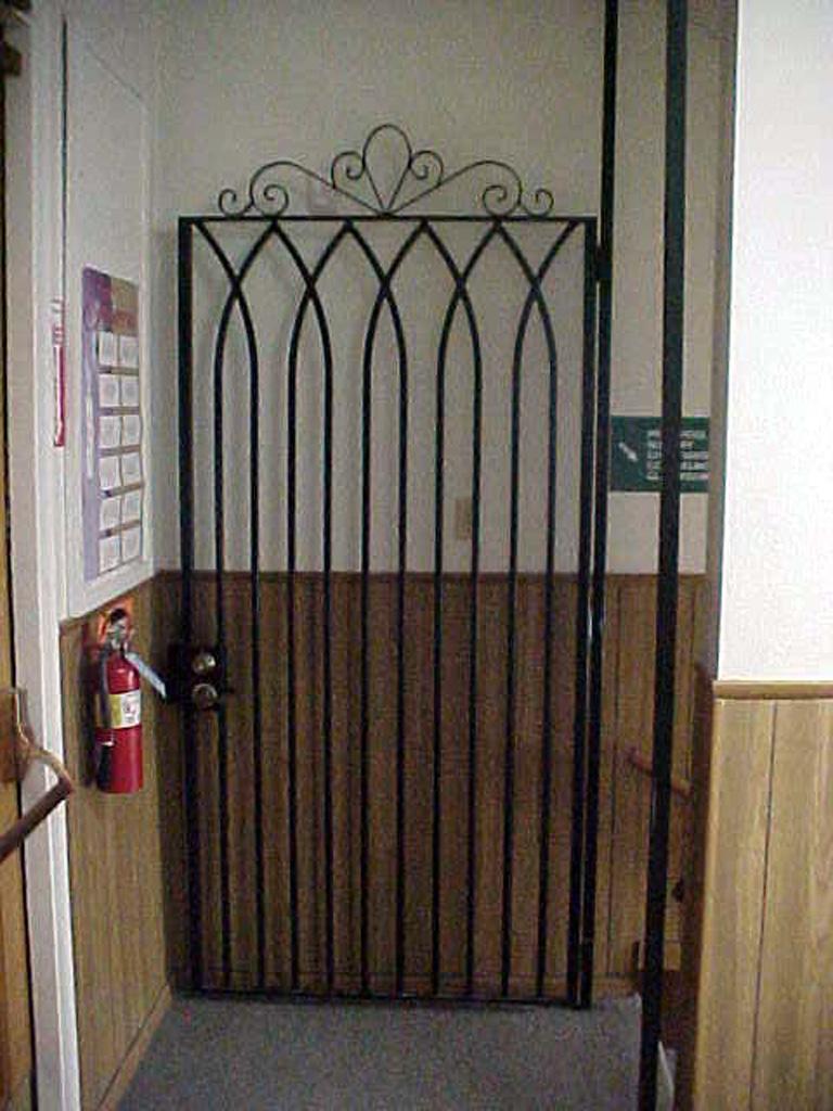 iron-anvil-gates-man-flat-scroll-top-presbyterian-church-1-2