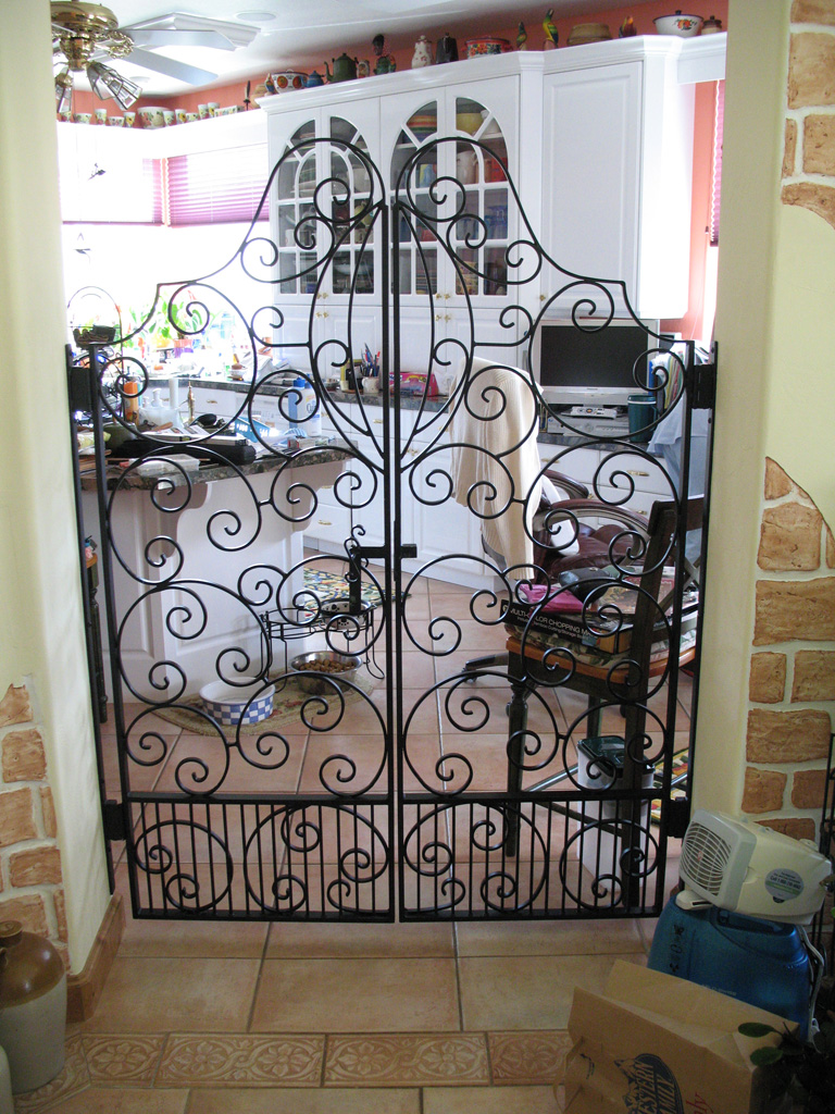 iron-anvil-gates-man-french-curve-scroll-top-aire-dr-park-city-1-2