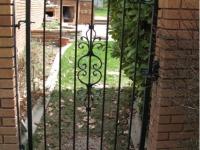 iron-anvil-gates-man-arch-0