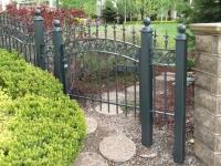 iron-anvil-gates-man-arch-chateau-on-the-green-railng