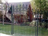iron-anvil-gates-man-arch-dog-guard-and-circles-at-the-top