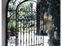 iron-anvil-gates-man-arch-muller-marcella