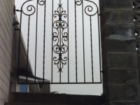 iron-anvil-gates-man-french-curve-scroll-top