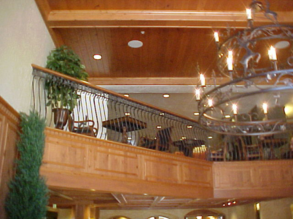 iron-anvil-railing-belly-rail-double-top-square-scroll-top-casting-zermatt-lobby-midway-5-4