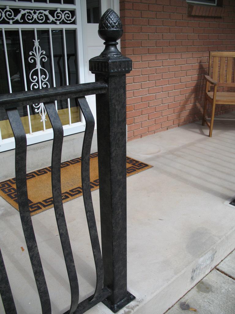 iron-anvil-railing-belly-rail-single-top-flat-bar-above-1300-east-1