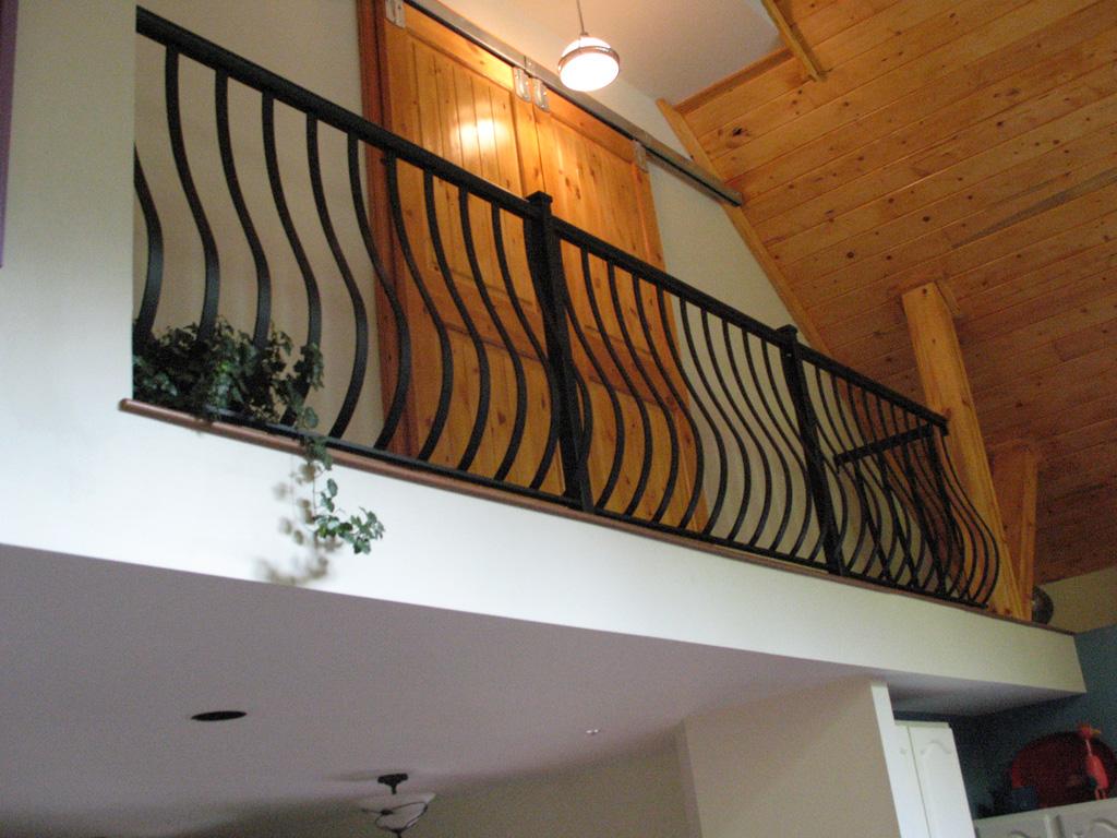 iron-anvil-railing-belly-rail-single-top-flat-bar-dan-byrne-immigration-2