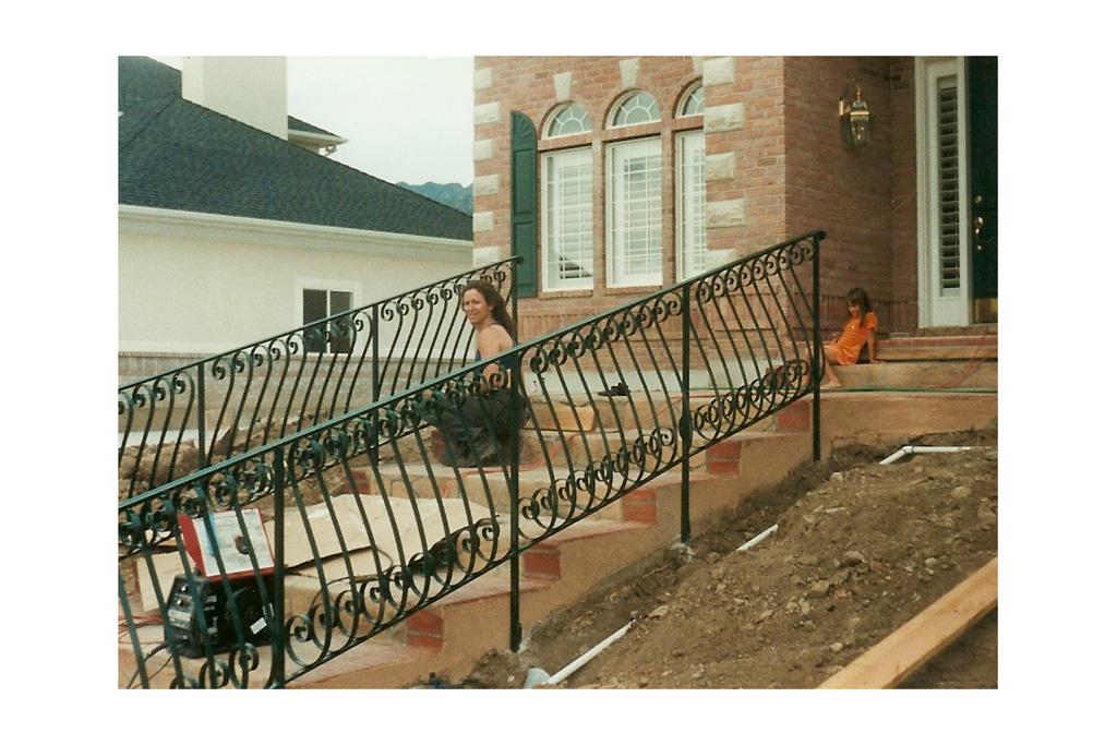 iron-anvil-railing-belly-rail-single-top-flat-bar-s-scroll-29-1015-bennett-belly-rail-1