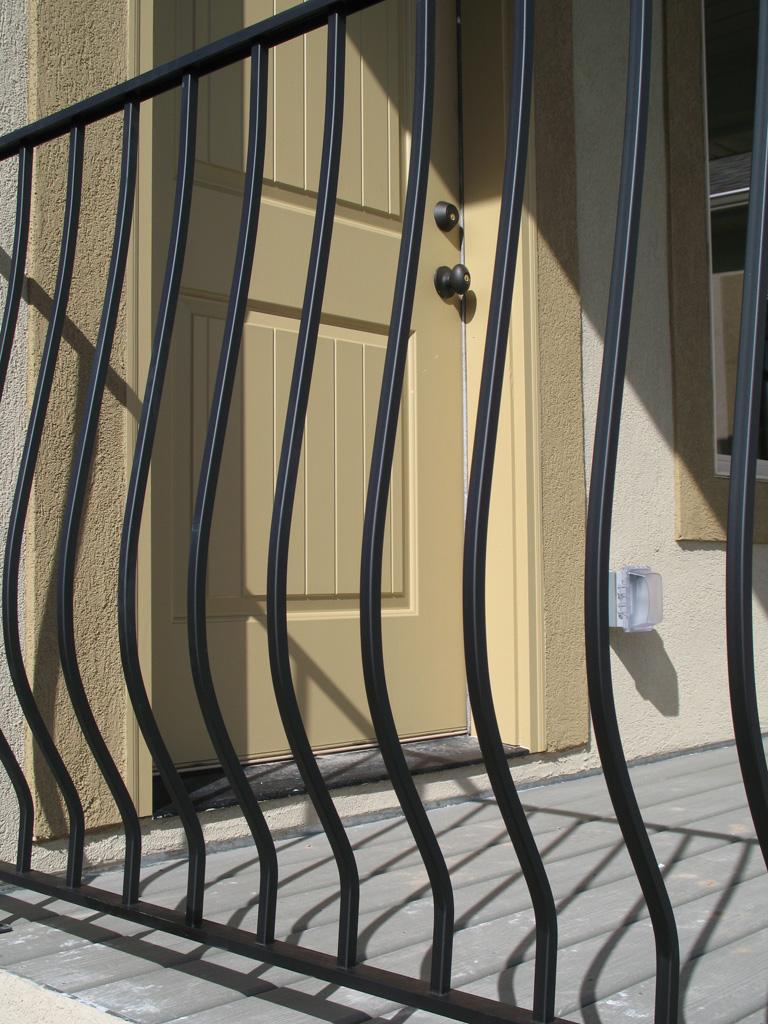 iron-anvil-railing-belly-rail-single-top-square-gold-medallion-herriman-lot-110