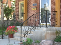 iron-anvil-railing-belly-rail-single-top-round-collars-on-elgin-30th-e-30th-s-2