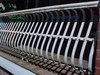 iron-anvil-railing-by-others-belly-rail-flowers-dorrell-on-2nd-ave