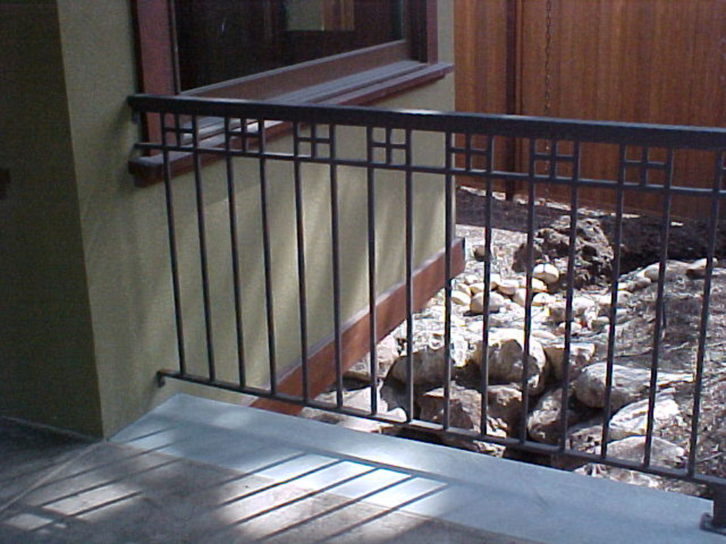 iron-anvil-railing-double-top-misc-crosses-on-top-off-holiday-blvd