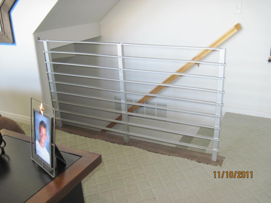 iron-anvil-railing-horizontal-round-bar-hansen-installation-2
