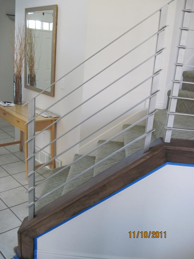 iron-anvil-railing-horizontal-round-bar-hansen-installation-5