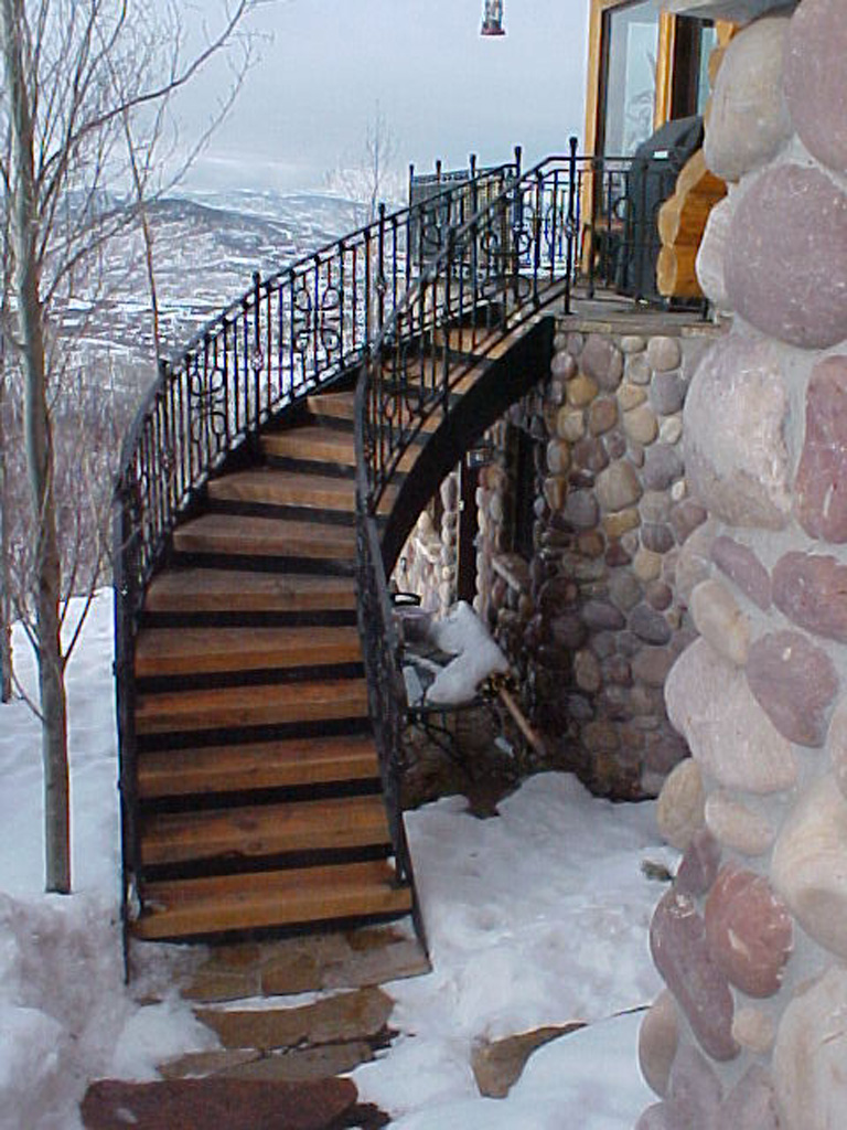 iron-anvil-railing-scrolls-and-patterns-panels-castings-circular-stair-park-city-2