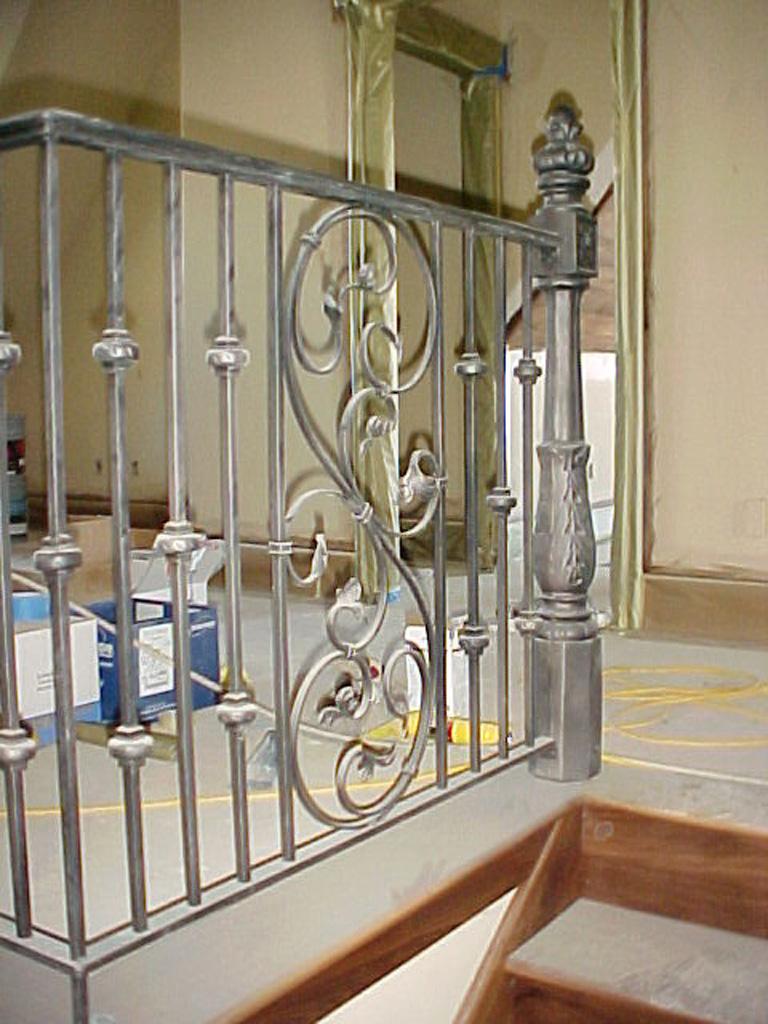 iron-anvil-railing-scrolls-and-patterns-panels-castings-yukon-const-bart-calrson-home-2