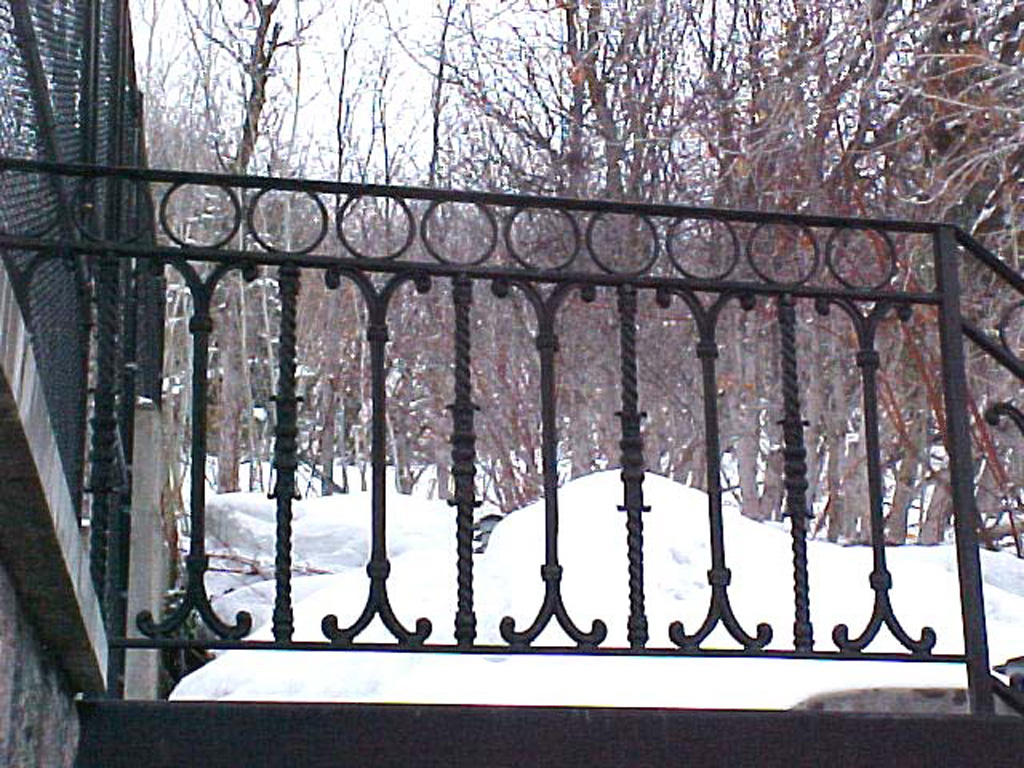 iron-anvil-railing-scrolls-and-patterns-repeating-circles-casting-rail-bountiful-by-dave-marks-1