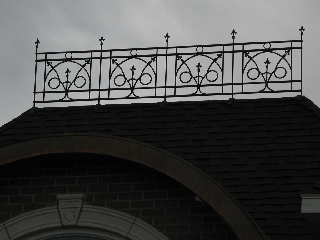 iron-anvil-railing-scrolls-and-patterns-repeating-circles-hopkins-belly-and-cat-walk-roof-highland-rail-1