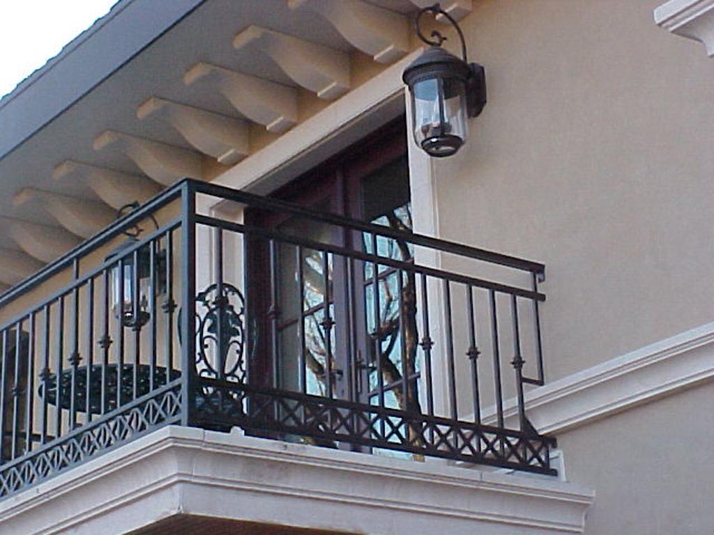 iron-anvil-railing-scrolls-and-patterns-repeating-collars-gustafson-guynn-on-yale-2