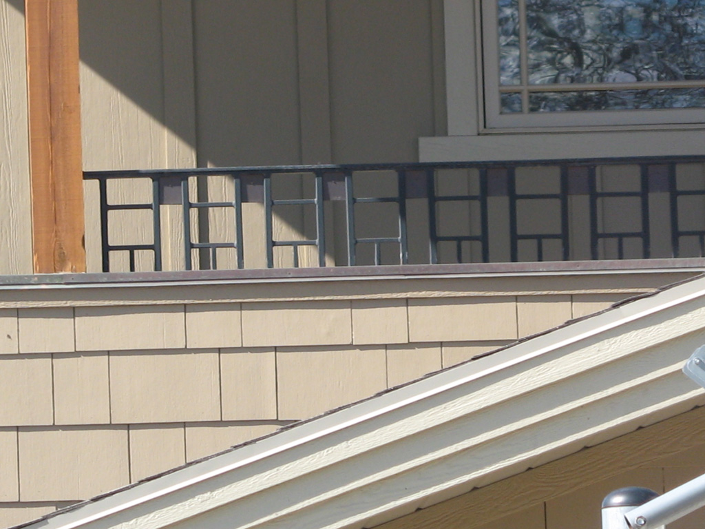 iron-anvil-railing-scrolls-and-patterns-repeating-grid-rail-by-others