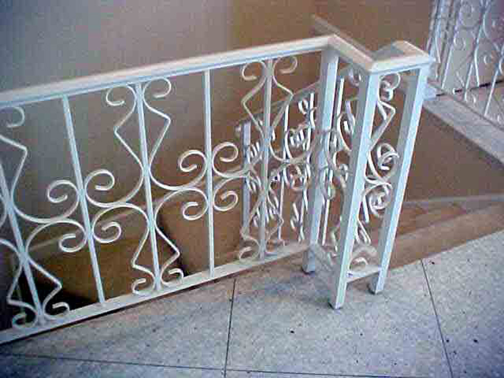 iron-anvil-railing-scrolls-and-patterns-repeating-steel-patterns-white-railing-by-others-1-1