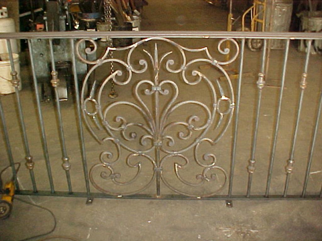 iron-anvil-railing-scrolls-and-patterns-window-bishop-curved-rail-1
