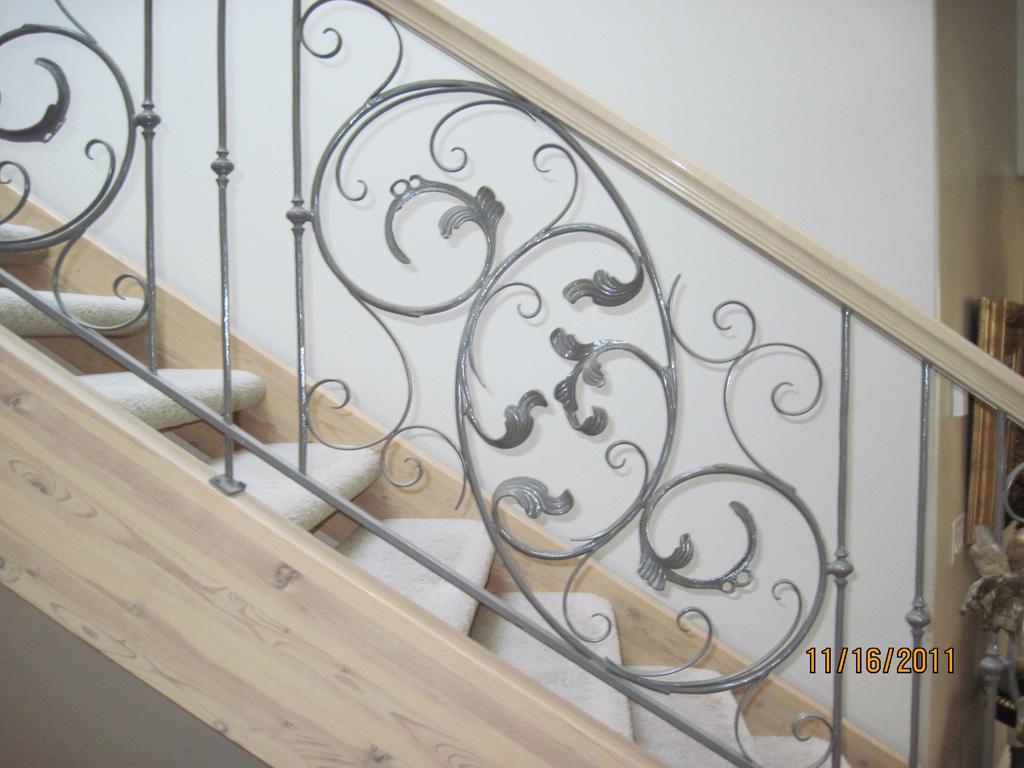iron-anvil-railing-scrolls-and-patterns-window-frendt-richard-15787-fancy-rail-1
