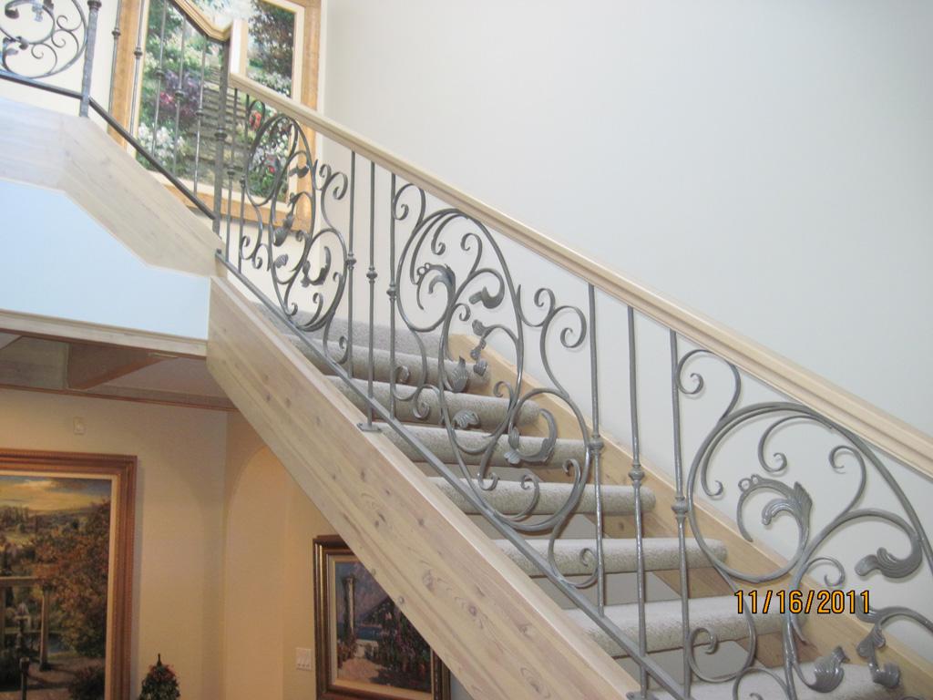 iron-anvil-railing-scrolls-and-patterns-window-frendt-richard-15787-fancy-rail-4